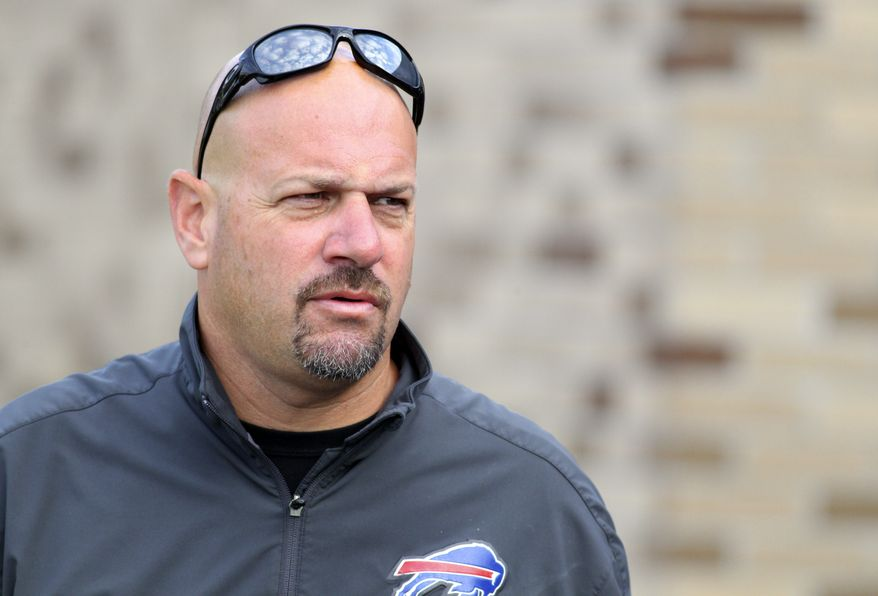 FILE - In this July 31, 2013, file photo, Buffalo Bills defensive coordinator Mike Pettine walks to the field during NFL football training camp in Pittsford, N.Y. Pettine has interviewed for the Cleveland Browns head coaching position, a person familiar with the Browns' plans told the Associated Press. Pettine interviewed with owner Jimmy Haslam and CEO Joe Banner last week and will have his second meeting on Tuesday night, Jan. 21, 2014, in Mobile, Ala., said the person who spoke on condition of anonymity because the team is not commenting during its search. Pettine is at the Senior Bowl in Mobile with other members of Buffalo's staff. (AP Photo/Bill Wippert, File)