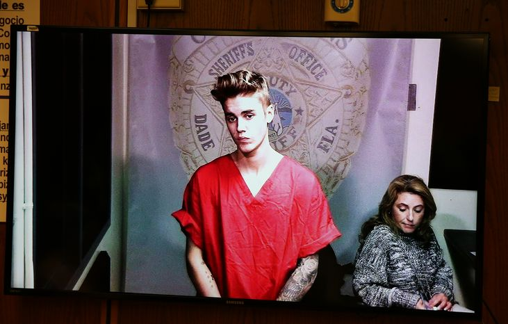 ** FILE ** Justin Bieber appears in court via video feed, Thursday, Jan. 23, 2014, in Miami. Bieber was released from jail Thursday following his arrest on charges of driving under the influence, driving with an expired license and resisting arrest. Police say they stopped the 19-year-old pop star while he was drag-racing down a Miami Beach street before dawn. (AP Photo/The Miami Herald, Walter Michot, Pool)