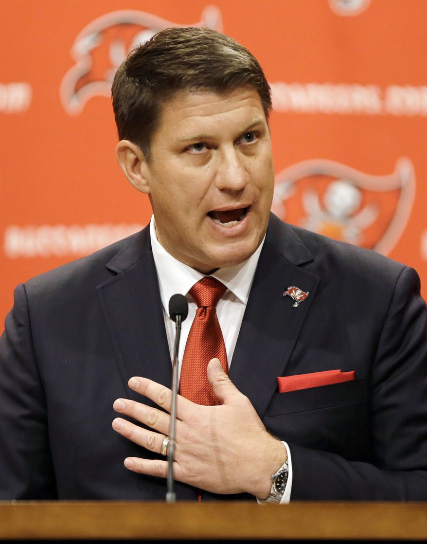 New Tampa Bay Buccaneers general manager Jason Licht gestures while speaking during an NFL football news conference Thursday, Jan. 23, 2014, in Tampa, Fla. Licht becomes the fifth general manager in team history.  He takes over a team that hasn't made the playoffs since 2007. (AP Photo/Chris O'Meara)