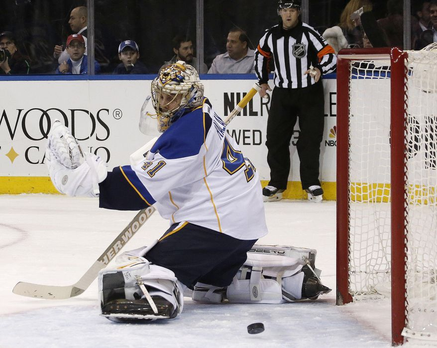 A shot by New York Rangers left wing Rick Nash sails by St. Louis Blues goalie Jaroslav Halak, of the Czech Republic, and wide of the goal during the second period of an NHL hockey game at Madison Square Garden in New York, Thursday, Jan. 23, 2014.  (AP Photo/Kathy Willens)