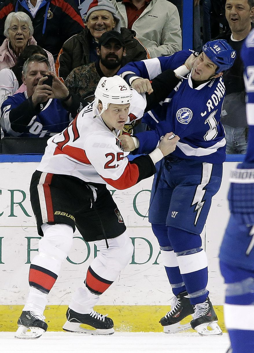 Ottawa Senators right wing Chris Neil (25) fights Tampa Bay Lightning right wing B.J. Crombeen (19) during the first period of an NHL hockey game Thursday, Jan. 23, 2014, in Tampa, Fla. Both players received five-minute fighting penalties. (AP Photo/Chris O'Meara)