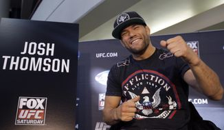 Mixed martial Arts fighter Josh Thomson, left, talks with reporters during a media availability at the United Center for his upcoming UFC fight, Thursday, Jan. 23, 2014, in Chicago. Thomson will face off against Benson Henderson on Saturday, Jan. 25, 2014. (AP Photo/Nam Y. Huh)