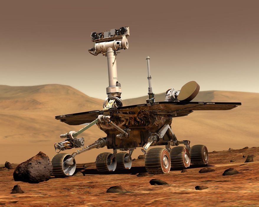 This artist rendering released by NASA shows the NASA rover Opportunity on the surface of Mars. Opportunity landed on the red planet on Jan. 24, 2004 and is still exploring. Its twin Spirit stopped communicating in 2010. (AP Photo/NASA)