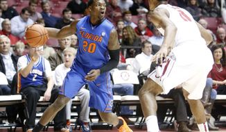 Florida guard Michael Frazier II (20) is pressured by Alabama's Algie Key (0) during an NCAA college basketball game at Coleman Coliseum in Tuscaloosa, Ala., Thursday, Jan. 23, 2014. (AP Photo/Michelle Lepianka Carter)