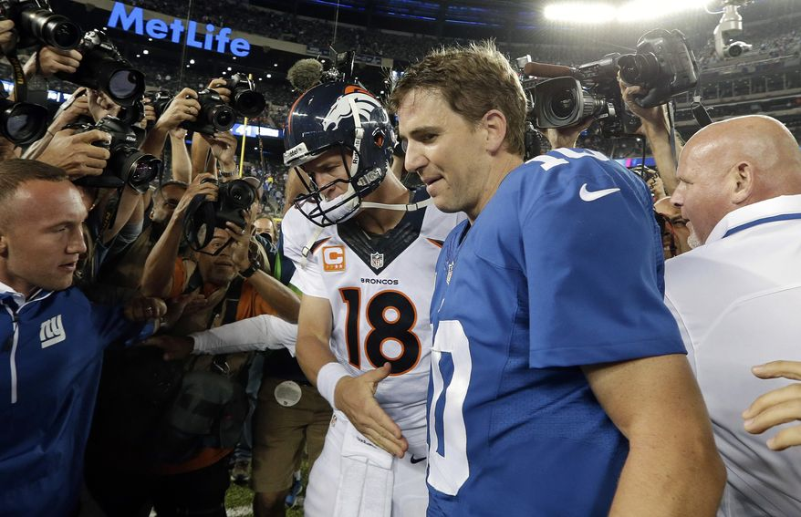 FILE - In this Sept. 15, 2013, file photo, Denver Broncos quarterback Peyton Manning (18) shakes hands with his brother New York Giants' quarterback Eli Manning (10) after an NFL football game  in East Rutherford, N.J. There is going to be a Manning in the Super Bowl, just not the one Eli Manning wanted.  (AP Photo/Frank Franklin II, File)