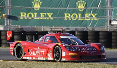 Alex Gurney drives through the infield course during his qualifying run for the IMSA Rolex 24 hour auto race at Daytona International Speedway in Daytona Beach, Fla., Thursday, Jan. 23, 2014. Gurney won the pole. AP Photo/John Raoux)