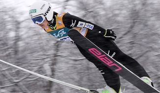 Japan's Sara Takanashi makes her jump in the women's ski jump World Cup event in Sapporo, northern Japan, Sunday, Jan. 12, 2014. Takanashi, 17, won her second straight event on home soil, continuing her dominance ahead of the Sochi Olympics. (AP Photo/Kyodo News)