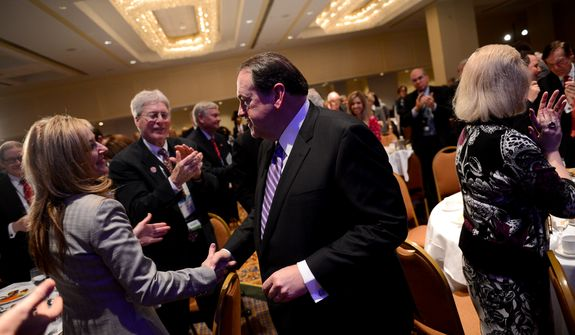 Mike Huckabee shakes hands with members of the audience after speaking during the Republican National Committee's annual winter meeting, Washington, D.C., Thursday, January 23, 2014. (Andrew Harnik/The Washington Times)