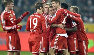 Bayern's Thomas Mueller is celebrated after scoring a penalty during the German Bundesliga soccer match between Borussia Moenchengladbach and Bayern Munich in Moenchengladbach,  Germany, Friday, Jan. 24, 2014. (AP Photo/Martin Meissner)