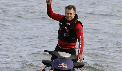 Contest director and founder Jeff Clark gives a thumbs up at the start of the second heat of the first round of the Mavericks Invitational big wave surf contest Friday, Jan. 24, 2014, in Half Moon Bay, Calif. (AP Photo/Eric Risberg)