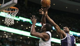Oklahoma City Thunder forward Serge Ibaka, right, reaches as he tries to block a shot by Boston Celtics forward Jeff Green during the first quarter of an NBA basketball game in Boston, Friday, Jan. 24, 2014. (AP Photo/Charles Krupa)
