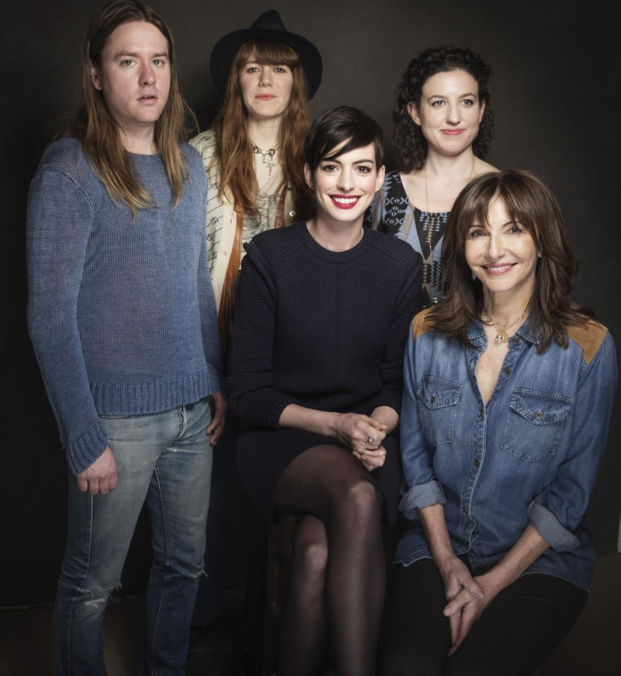 """In this Tuesday, Jan. 21, 2014 photo, from left, composers Johnny Rice and Jenny Lewis, actress Anne Hathaway, director Kate Barker-Froyland and actress Mary Steenburgen of the movie """"Song One"""" pose for a portrait at The Collective and Gibson Lounge Powered by CEG, during the Sundance Film Festival, in Park City, Utah. The film had its premiere at the 2014 Sundance Film Festival. (Photo by Victoria Will/Invision/AP)"""