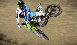 In this undated photo provided by the Wasserman Media Group, motocross rider Chad Reed flies over a jump.  heard the whispers that he was washed up. When his winless streak kept growing, he began to wonder if maybe he was close to the end. Last week's win at Anaheim changed everything for the 31-year-old Aussie. (AP Photo/Wasserman Media Group)