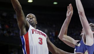 Detroit Pistons guard Rodney Stuckey (3) goes in for a layup against New Orleans Pelicans center Jeff Withey during the first half of an NBA basketball game Friday, Jan. 24, 2014, in Auburn Hills, Mich. (AP Photo/Duane Burleson)