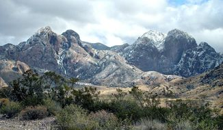 In this Dec. 28, 2006, image, the Organ Mountains near Las Cruces, N.M., are left with a light dusting of snow. Interior Secretary Sally Jewell is visiting Las Cruces on Friday, Jan. 24, 2013, for a tour and a public hearing to discuss legislation that would designate the desert mountain range and other scenic areas around Dona Ana County as a national monument. (AP Photo/Las Cruces Sun-News, Shari Vialpando)