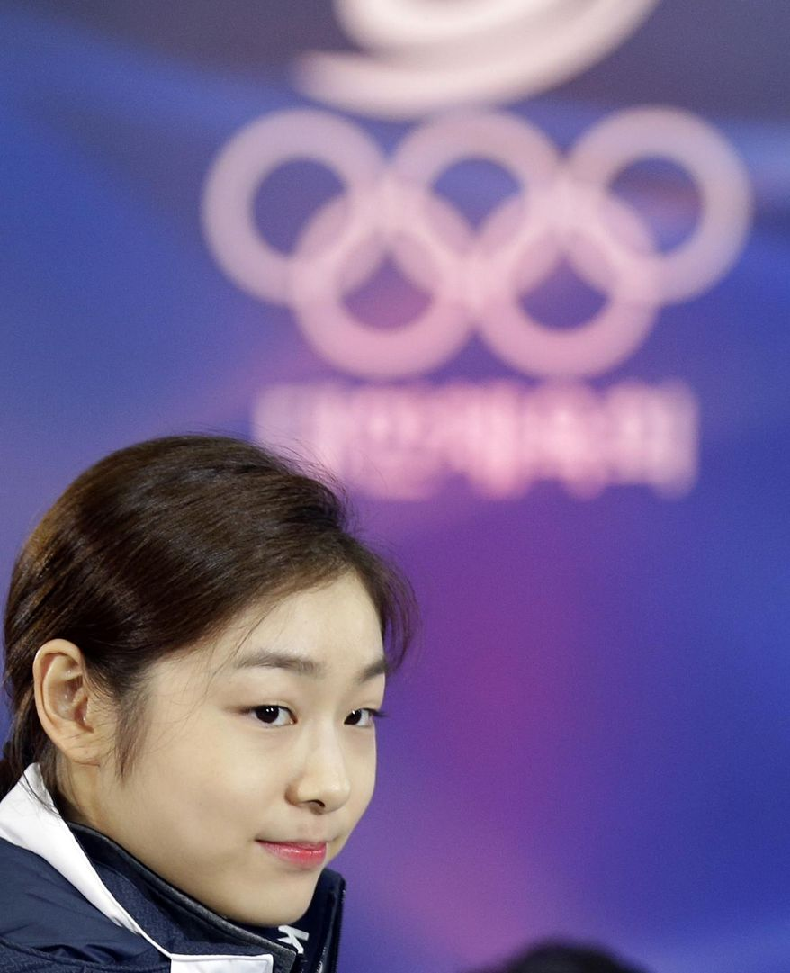 South Korean Kim Yuna, Vancouver gold medalist for the women's figure skating, attends the inaugural ceremony of the South Korean team for the Sochi Winter Olympics in Seoul, South Korea, Thursday, Jan. 23, 2014. South Korea will send 64 athletes to Sochi which will be held from Feb. 7-23. (AP Photo/Lee Jin-man)