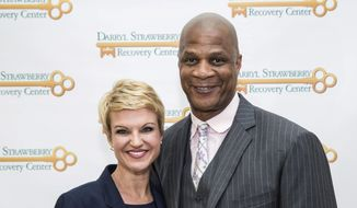 In this file photo, Tracy Strawberry, left, and her husband, former baseball player Darryl Strawberry, pose at an event for the Darryl Strawberry Recovery Center in St. Cloud, Fla., Friday, Jan. 24, 2014.  (AP Photo/Willie J. Allen Jr.) **FILE**