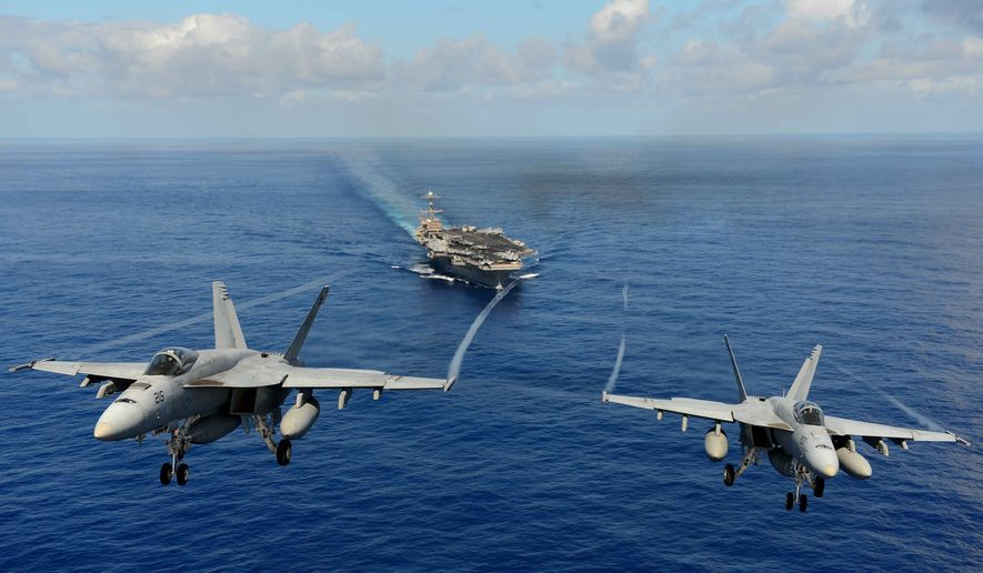 Two F/A-18E Super Hornets from the Tophatters of Strike Fighter Squadron (VFA) 14 participate in an air power demonstration over the aircraft carrier USS John C. Stennis (CVN 74) in the Pacific Ocean in this April 24, 2013, file photo. (U.S. Navy photo by Mass Communication Specialist Seaman Apprentice Ignacio D. Perez/Released) ** FILE **