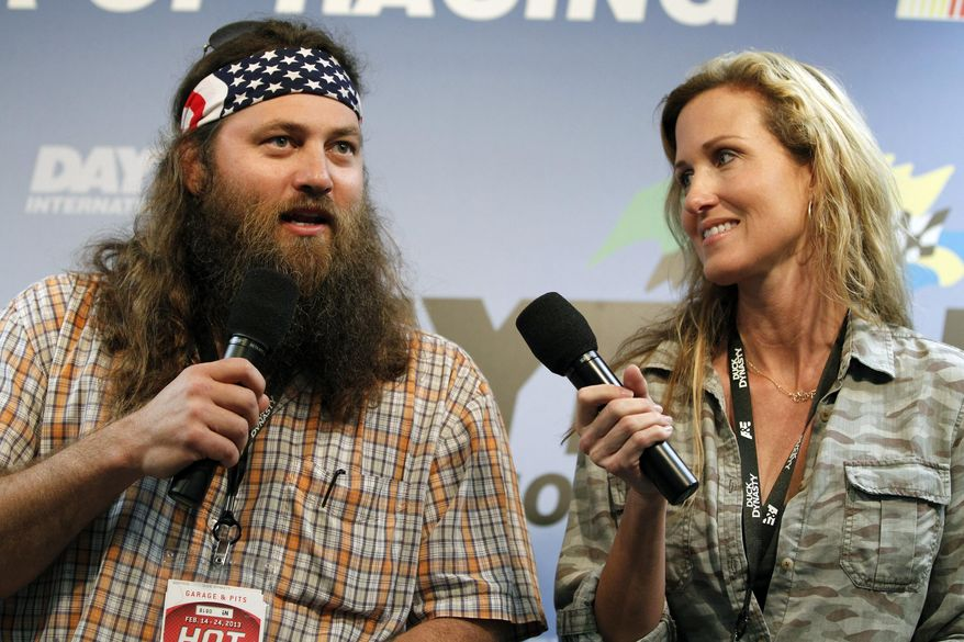 """** FILE ** This Feb. 24, 2013, file photo shows Willie Robertson, left, and Korie Robertson, of the reality TV show, """"Duck Dynasty,"""" before the Daytona 500 NASCAR Sprint Cup Series auto race, at Daytona International Speedway in Daytona Beach, Fla. (AP Photo/Terry Renna, File)"""