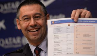 FC Barcelona's president Josep Maria Bartomeu shows a paper with detaitls of the contract of Neymar at the Camp Nou stadium in Barcelona, Spain, Friday, Jan 24, 2014. Barcelona says its board of directors is calling an ''extraordinary'' meeting, fueling Spanish media reports that club president Sandro Rosell is under pressure to consider stepping down due to the lawsuit regarding Neymar's transfer. Barcelona said in a statement that the meeting will take place on Thursday afternoon, a day after a judge agreed to hear a lawsuit brought by a Barcelona club member over the cost of Neymar's signing. (AP Photo/Manu Fernandez)