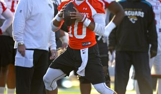South Squad quarterback Jimmy Garoppolo, of Eastern Illinois, drops back to pass during Senior Bowl college football practice at Ladd-Peebles Stadium, Thursday, Jan. 23, 2014, in Mobile, Ala.  (AP Photo/G.M. Andrews)
