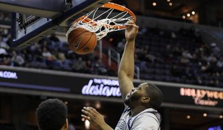 Georgetown center Joshua Smith, center, dunks against Lipscomb forward Malcolm Smith (52) and Josh Williams (2) during the second half of an NCAA college basketball game, Saturday, Nov. 30, 2013, in Washington. Georgetown won 70-49. (AP Photo/Nick Wass) **FILE**
