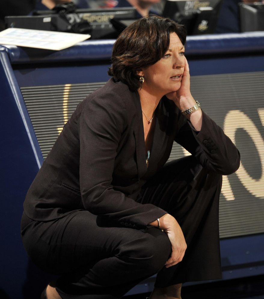 Miami coach Katie Meier watches her team during the first of an NCAA college basketball game against Notre Dame, Thursday, Jan. 23, 2014 in South Bend, Ind. (AP Photo/Joe Raymond)