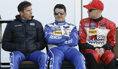 Ganassi Racing drivers, from left, Scott Pruett, Memo Rojas, of Mexico, and Marino Franchitti, of Scotland,practice for the IMSA Series Rolex 24 hour auto race at Daytona International Speedway in Daytona Beach, Fla., Friday, Jan. 24, 2014.(AP Photo/John Raoux)