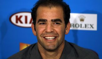 Former World No.1 Pete Sampras smiles during a press conference marking the 20th anniversary of his first Australian Open win,  at the Australian Open tennis championship in Melbourne, Australia, Friday, Jan. 24, 2014. (AP Photo/Aijaz Rahi)