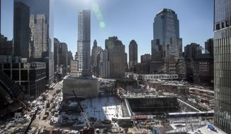 ** FILE ** A view from 7 World Trade Center shows ongoing construction at the World Trade Center site on Friday Jan. 24, 2014, in New York. (AP Photo/Bebeto Matthews)