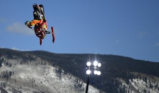 Colten Moore rides his sled during a snowmobile freestyle practice session Thursday Jan. 23, 2014, in Aspen, Colo. Moore's older brother, Caleb Moore, died last year as a result of an injury suffered in the snowmobile freestyle competition. (AP Photo/ The Denver Post, AAron Ontiveroz)