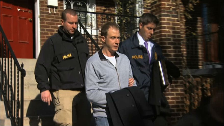 ** FILE ** This Dec. 11, 2013, image from video provided by WJLA-TV, shows Ryan Loskarn, former chief of staff to Sen. Lamar Alexander, R-Tenn., being escorted from his Washington home by U.S. Postal Inspector police. Loskarn has been found dead in Maryland, just weeks after the former staffer's arrest on child pornography charges. (AP Photo/WJLA-TV)