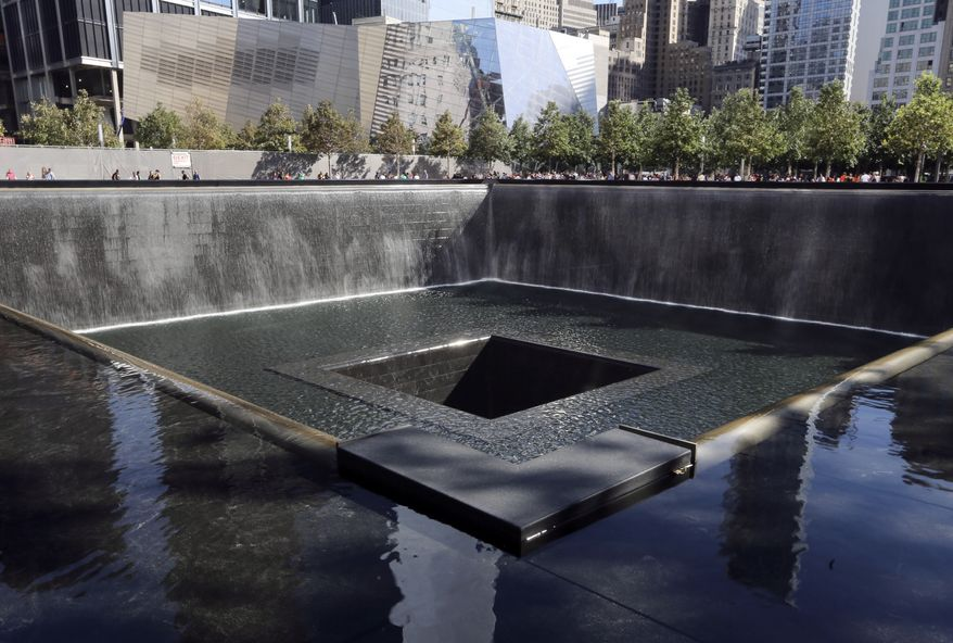 FILE - In this Sept. 6, 2013, file photo, The National September 11 Museum is seen beyond the North Pool at the memorial in New York. New York City Mayor Bill de Blasio called upon the federal government Wednesday, Jan. 15, 2014, to help support the Sept. 11 museum at the World Trade Center, which is set to open this spring after years of delays but is potentially facing budget shortfalls. (AP Photo/Mary Altaffer, File)