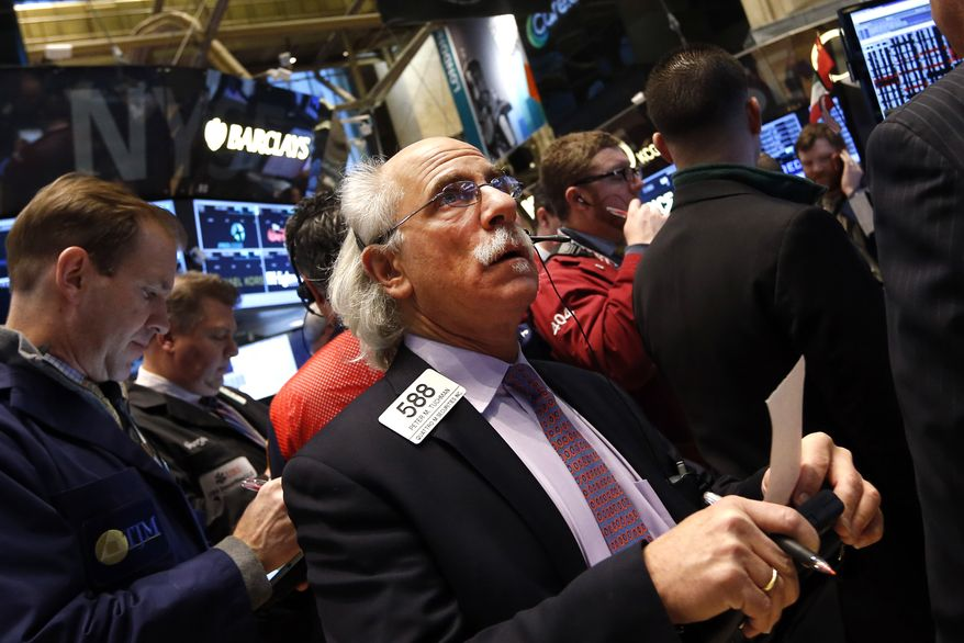Trader Peter Tuchman works on the floor of the New York Stock Exchange Friday, Jan. 24, 2014.  (AP Photo/Jason DeCrow)