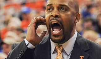 Tennessee coach Cuonzo Martin shouts out to his team during the second half of an NCAA college basketball game against Florida Saturday, Jan. 25, 2014, in Gainesville, Fla. (AP Photo/Phil Sandlin)