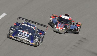 Oswaldo Negri Jr. (60), of Brazil, in the Michael Shank Racing Riley DP, and Andy Merick (0), of England, in the DeltaWing DWC13, drive though the front stretch in the early laps of  IMSA Series Rolex 24 hour auto race at Daytona International Speedway in Daytona Beach, Fla., Saturday, Jan. 25, 2014.(AP Photo/John Raoux)