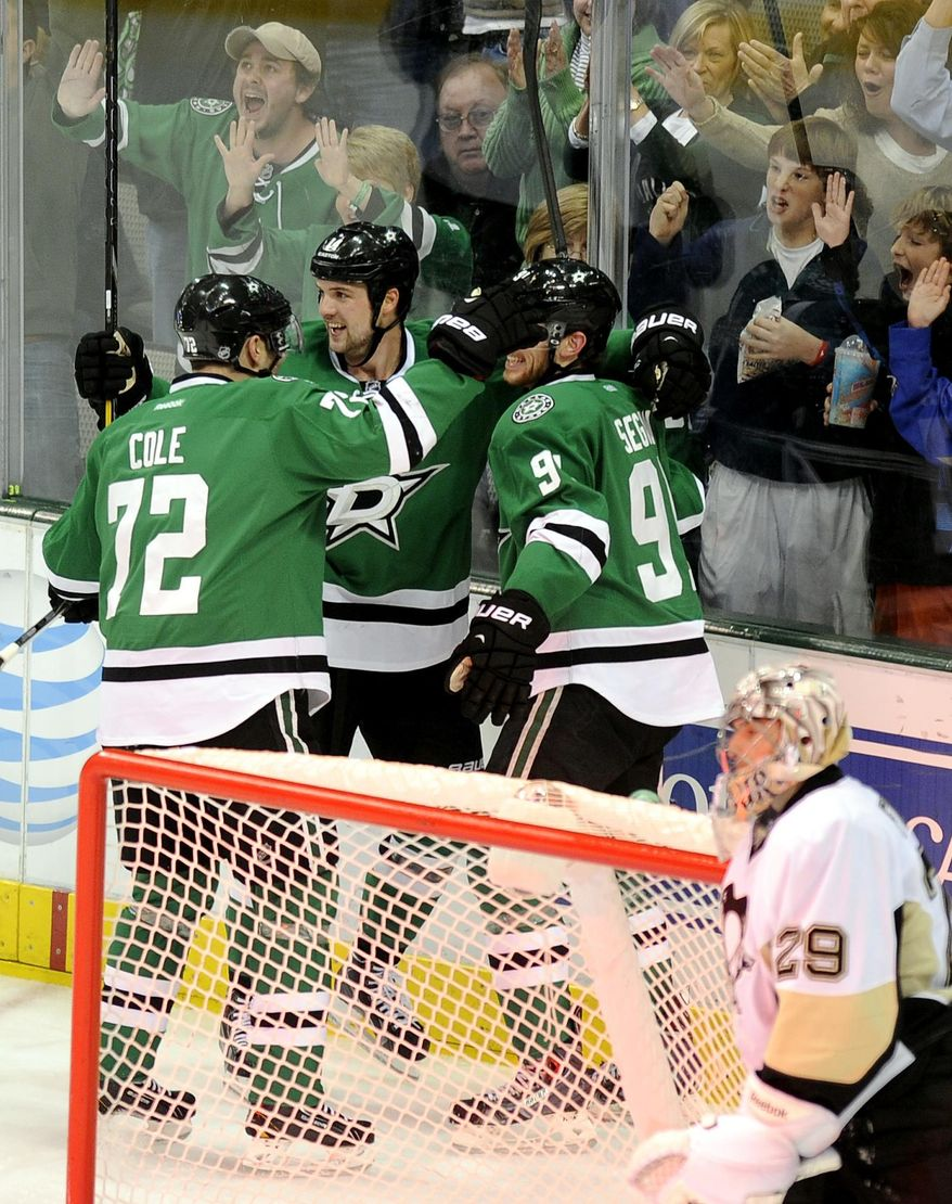 Dallas Stars left wing Jamie Benn  celebrates his second period goal with right wing Erik Cole (72) and center Tyler Seguin (91) as Pittsburgh Penguins goalie Marc-Andre Fleury (29) looks on during an NHL hockey game, Saturday, Jan. 25, 2014, in Dallas. (AP Photo/Matt Strasen)