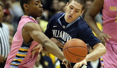 Marquette's John Dawson, left and Villanova's Ryan Arcidiacono reach for a loose ball during the first half of an NCAA college basketball game Saturday, Jan. 25, 2014, in Milwaukee. (AP Photo/Jeffrey Phelps)