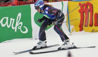 Winner Ophelie David of France celebrates in the finish area after the women's Ski Cross   World Cup  in Kreischberg, Austria, on Saturday, Jan. 25. 2014. (AP Photo/Kerstin Joensson)
