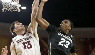 Arizona State's Jordan Bachynski (13) blocks the shot of Colorado's Jaron Hopkins (23) during the first half of an NCAA college basketball game Saturday, Jan. 25, 2014, in Tempe, Ariz. (AP Photo/Ross D. Franklin)