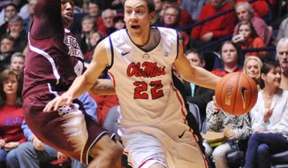 Mississippi's Marshall Henderson (22) drives past Mississippi State's  Trivante Bloodman (4) to score during an NCAA  college basketball game, Saturday, Jan. 25, 2014 in Oxford, Miss.  (AP Photo/Oxford Eagle, Bruce Newman) MAGS OUT; NO SALES MANDATORY CREDIT