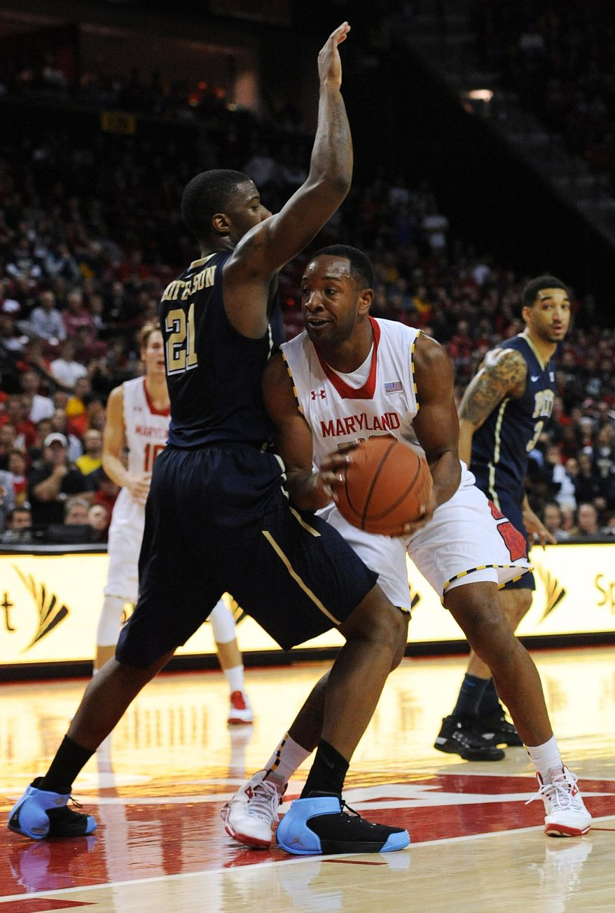 Maryland's Dez Wells, right, is stopped by Pittsburgh's Lamar Patterson in the second half of an NCAA college basketball game Saturday, Jan. 25, 2014, in College Park, Md. Pittsburgh won 83-79. (AP Photo/Gail Burton)