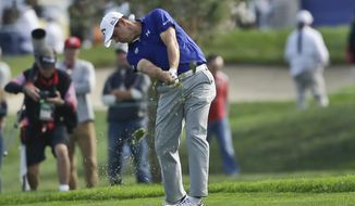Gary Woodland hits on the first hole of the South Course at Torrey Pines, on which he made a birdie during the third round of the Farmers Insurance Open golf tournament Saturday, Jan. 25, 2014, in San Diego. (AP Photo/Lenny Ignelzi)