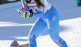 First placed Tina Maze, of Slovenia,  celebrates at the end of an alpine ski World Cup women's downhill in Cortina D' Ampezzo, Italy, Saturday, Jan. 25, 2014. (AP Photo/Armando Trovati)