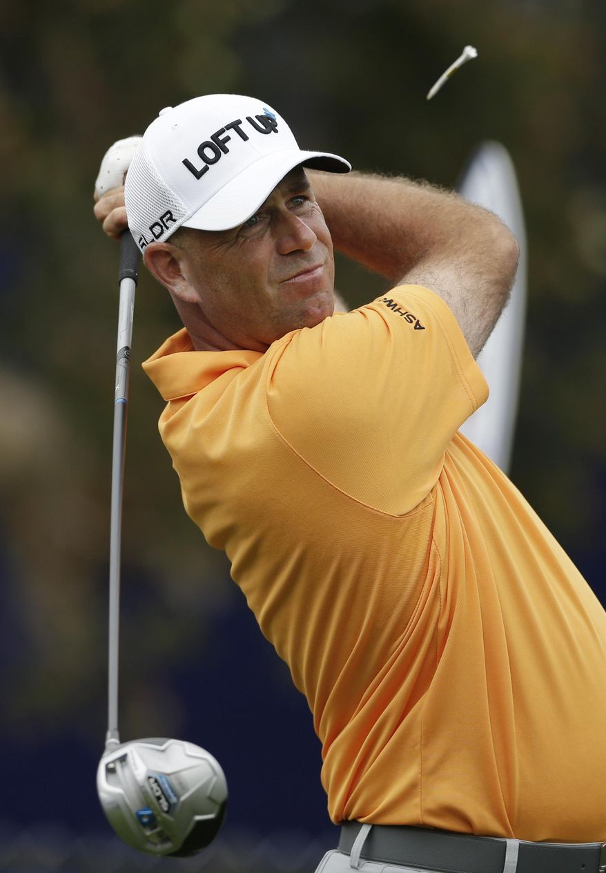 Stewart Cink watches his tee shot on the seventh hole of the South Course during the second round of the Farmers Insurance Open golf tournament Friday, Jan. 24, 2014, in San Diego. (AP Photo/Gregory Bull)