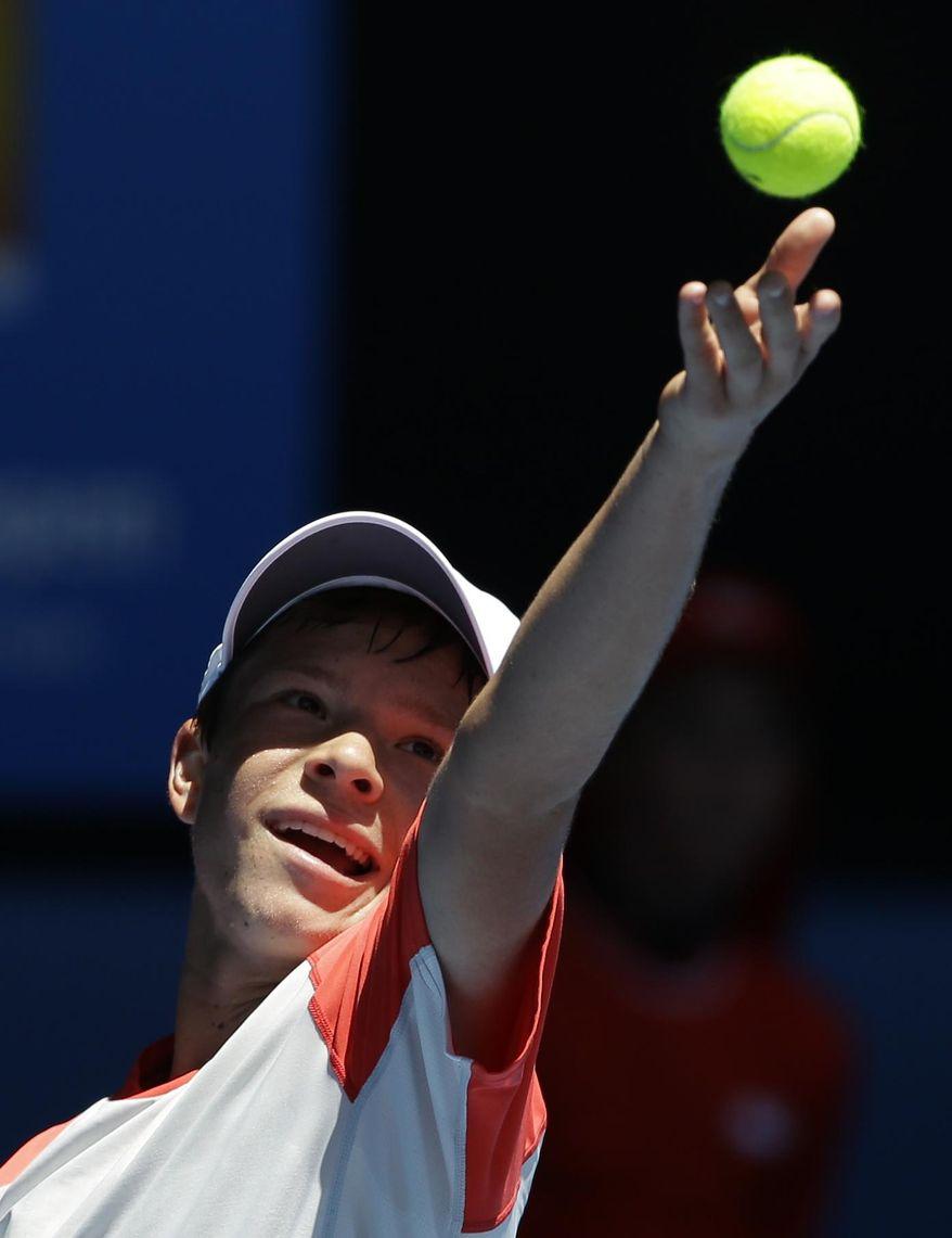 Stefan Kozlov of the U.S. serves to Alexander Zvere of Germany at the Australian Open boy's tennis final in Melbourne, Australia, Saturday, Jan. 25, 2014. (AP Photo/Aijaz Rahi)