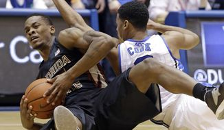 Duke's Quinn Cook, right, and Florida State's Aaron Thomas struggle for possession of the ball during the first half of an NCAA college basketball game in Durham, N.C., Saturday, Jan. 25, 2014. (AP Photo/Gerry Broome)