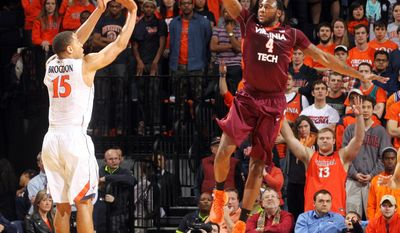 Virginia guard Malcolm Brogdon (15) shoots a 3-point basket over Virginia Tech forward Cadarian Raines (4) during an NCAA college basketball game Saturday, Jan. 25, 2014, in Charlottesville, Va. (AP Photo/The Daily Progress, Andrew Shurtleff)