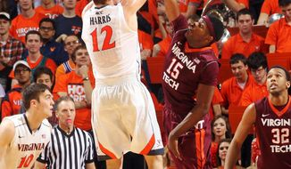 Virginia guard Joe Harris (12) is fouled by Virginia Tech guard Ben Emelogu (15) as he shoots the ball during an NCAA college basketball game Saturday, Jan. 25, 2014, in Charlottesville, Va. (AP Photo/The Daily Progress, Andrew Shurtleff)