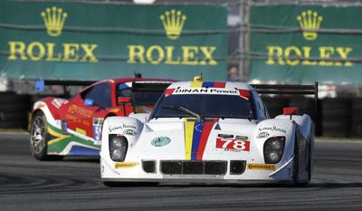 Brendan Hartley (78), of New Zealand, drives the Dinan/Riley through a turn and passes Matt Griffin, of Ireland, in the Spirit of Race Ferrari 458 Italia, during the IMSA Series Rolex 24 hour auto race at Daytona International Speedway in Daytona Beach, Fla., Saturday, Jan. 25, 2014.(AP Photo/John Raoux)